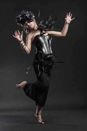 Glamour gothic fashion woman in black dress