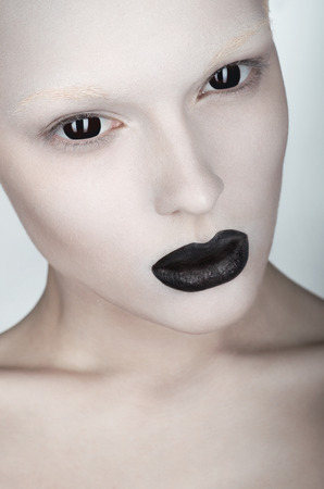 creepy alien: Woman face with white skin and black lips