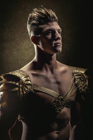 strong: Strong man in golden armor Stock Photo