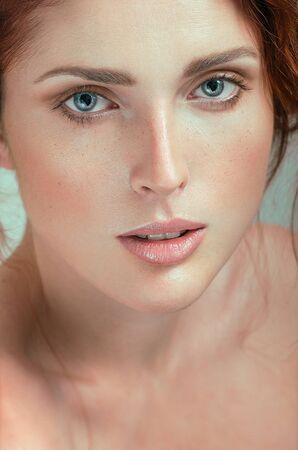 women subtle: Beautiful woman with freckles. Natural portrait.
