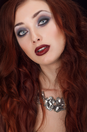 causcasian: Vampire redhead woman with silver necklace