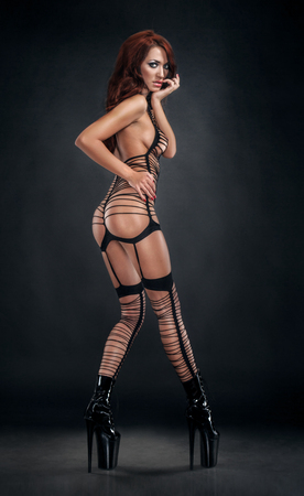 mesh: Sexy woman in black fishnet costume