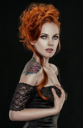 Posh redhead woman in black dress