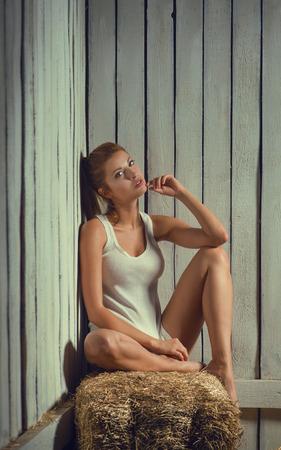 hayloft: Sexy woman on hayloft