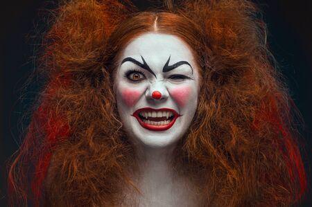 evil clown: Crazy female clown portrait