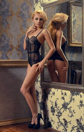 wall mirror: Sexy woman in black sexy lingerie