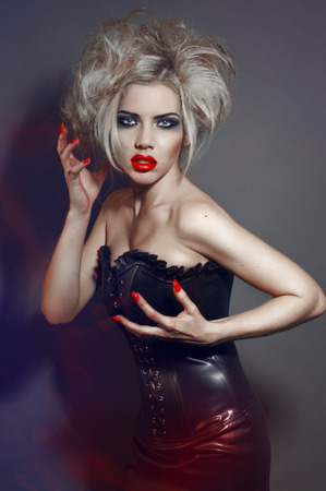 femme fatale: Portrait of young gothic girl with red lips and nails Stock Photo