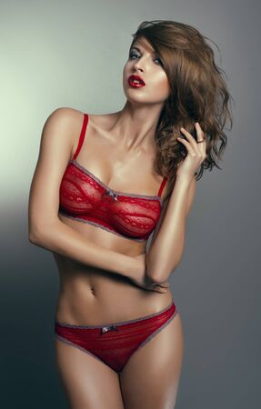 breast sexy: Sexy woman in red lingerie Stock Photo
