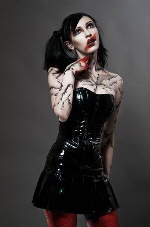 gothic fetish: Young gothic girl Stock Photo