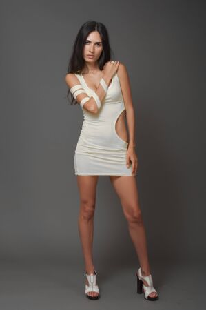 Brunnet woman in white short dress