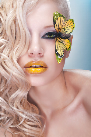 yellow butterflies: Blonde curly woman with yellow butterfly on lashes