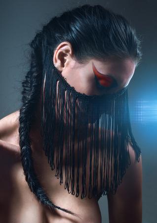 fringe: Dark portrait with black fringe on face Stock Photo