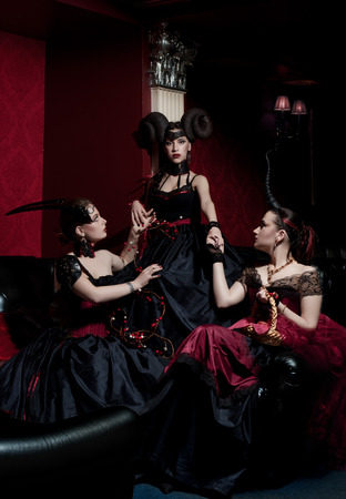 Three gothic girls with horns