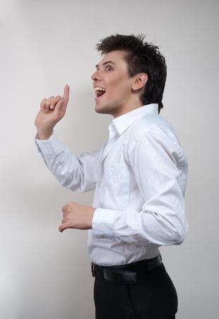dishevelled: Handsome man in white shirt. Studio white background. Stock Photo