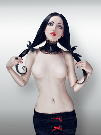 girl boobs: Ball jointed doll with pigtails