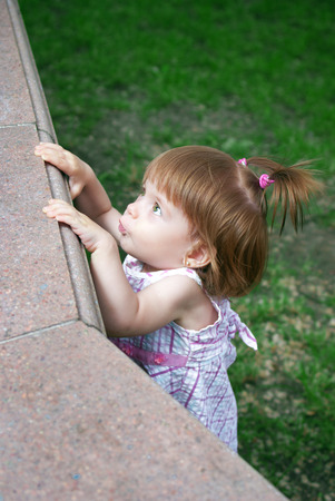 curiously: Little girl looking curiously outdoor Stock Photo