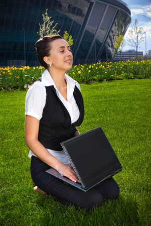 netbook: Portrait of young business woman holding netbook Stock Photo