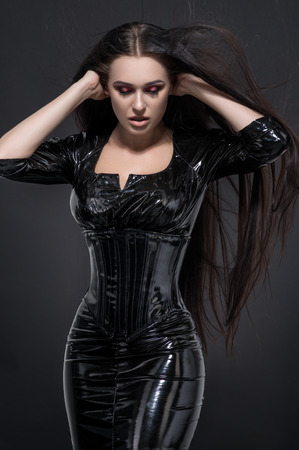 vamp: Vamp woman with red eyes, long hair in black sexy dress