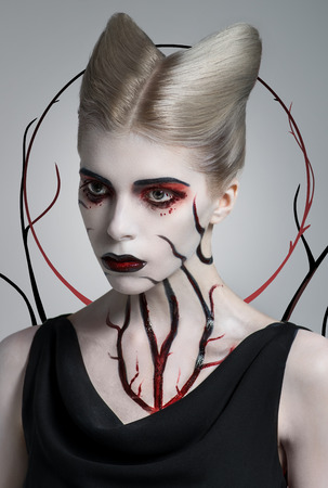 scary girl: Scary girl with bloody body art on white skin Stock Photo