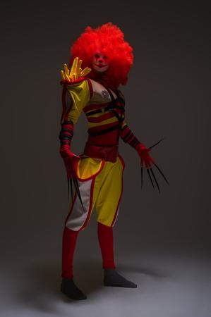 Evil clown: Tall evil clown Stock Photo