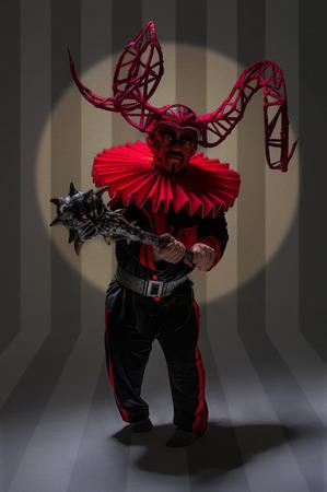 Evil clown: Small evil clown with stick