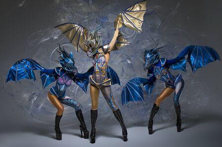 bodyart: Women with beautiful dragons body-art, masks and wings