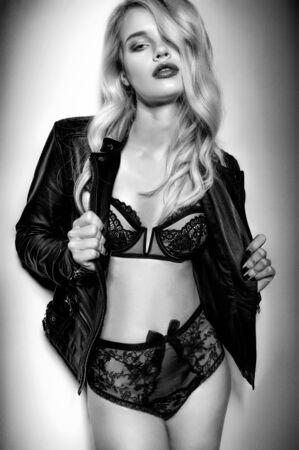 dark backgrounds: Monochrome sexy blonde in dark lingerie