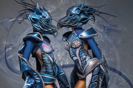 bodyart: Two Women with beautiful blue dragons body-art and masks Stock Photo
