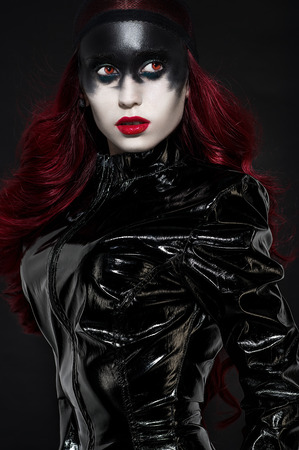 red haired woman: Red haired woman with weird black makeup in latex clothes