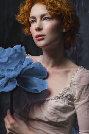 eye red: Redhead girl with big blue flower
