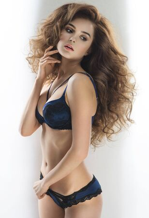 and the magnificent: Sexy woman with magnificent hair in blue lingerie