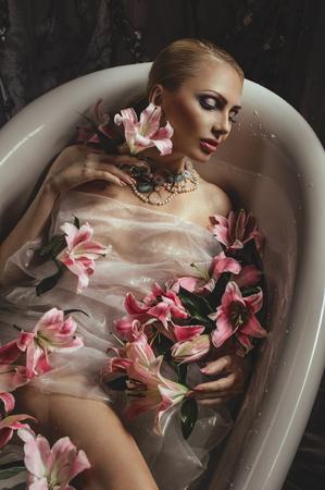 woman in bath: Beautiful woman in bath with flowers