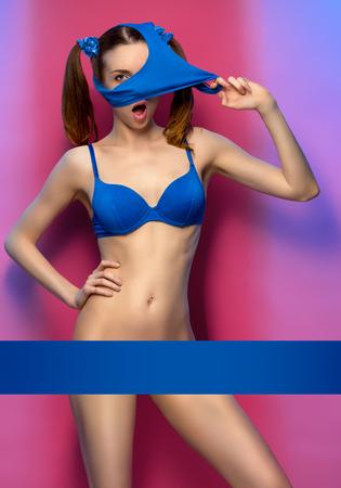 Young woman posing in bikini without panties, bottom of bikini on head Stock Photo