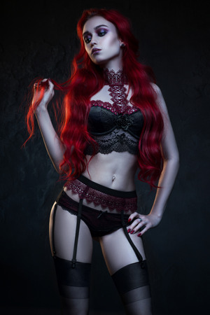 Beautiful gothic woman in underwear posing at camera