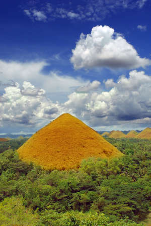 natural landmark: One Bohol Chocolate Hill, a natural landmark and a very prominent and famous tourism geography spot in the Philippines, colorful and under a majestic cloudscape.