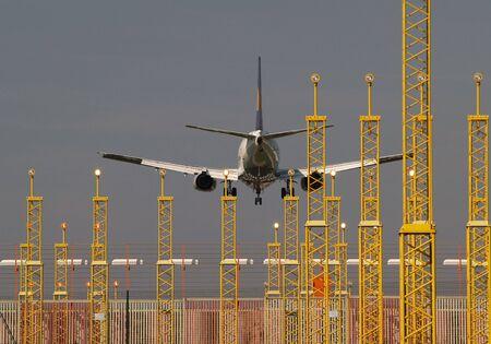 Airplanes landing on Brussels International Airport, Zaventem, Belgium. Approach and landing lights. Zdjęcie Seryjne