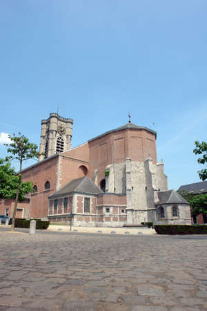 walloon: St.-Julien church in the center of the small Walloon city of Ath, Belgium. The bell-tower is XV-th century and in granite; the church itself is in red bricks. Stock Photo