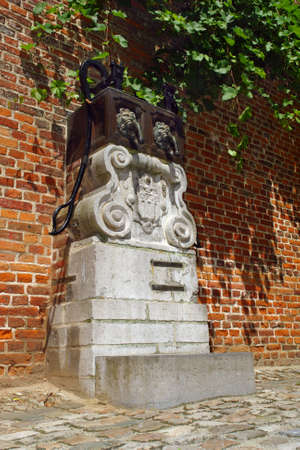 middleages: Medieval public water pump in a Belgian beguinage. Stock Photo