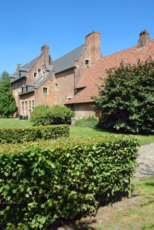middleages: Medieval houses in the Spanish Quarter of the Louvain (Belgium) beguinage. View from the park outside.