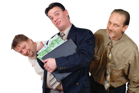 Three slick punk-like doubtful sales or business men grinning with laptop and euro bills. Concept of doubtful financial transactions on the Internet. slick trade practices, online hoaxes, criminal gain, spamming, phishing and fraud. Zdjęcie Seryjne
