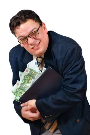 Greedy salesman holding on to his laptop PC stacked with euro bank notes with an apparent grimace of a lucrative but slick sale.
