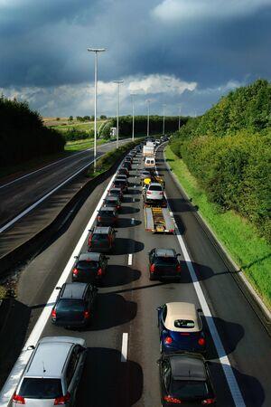 Traffic jam during rush hour on a Belgian highway near sunset.