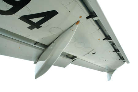 airstream: Detail of commercial airliner wing, isolated over white. Stock Photo