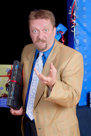 Convincing and prompting businessman posing with his new Christmas present, a laptop PC. Stock Photo - 1656752