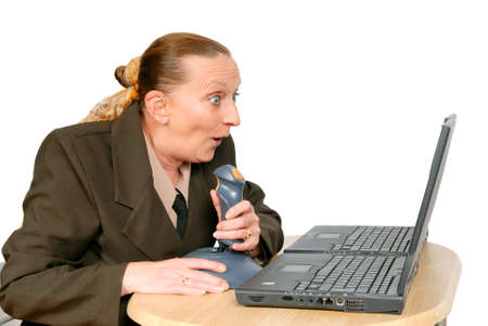 snappy: Businesswoman shooting with joystick online, in front of two laptop PCs, looking for opportunities, a snappy shot, and a market hit. Isolated over white. Stock Photo