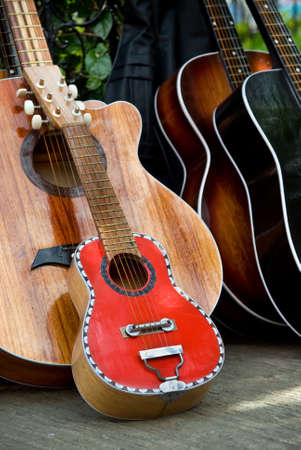 Two famous colorful Cebu handmade and manually crafted painted guitars - a large and small one - aligned outdoors in Cebu City (Philippines) downtown on a street sale. Stock Photo