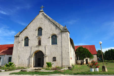 parish: Historic Filipino coral stone Catholic parish church in Squijor City on Siquijor Island, built in 1870 near the pier and dedicated to St. Francis of Assisi. Stock Photo