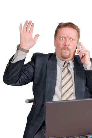 amazement: Travelling businessman or salesman with laptop calling, receiving bad news and raising hand in a despair gesture. Isolated over white.