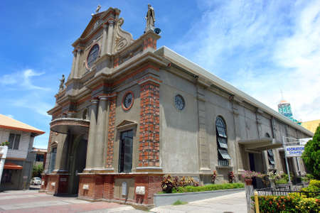 Dumaguete Cathedral, the oldest stone Catholic church on the Filipino island of Negros. Built in the 16-th century, burnt down in the 18-th and rebuilt in the early 20-th century in neo-baroque style. Dedicated to St. Catherine of Alexandria. photo