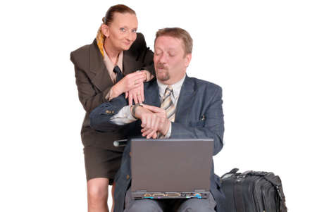 travelling salesman: Traveling businessman and businesswoman in suit and with laptop PC consulting their time schedule.